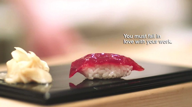 A screenshot from the movie 'Jiro Dreams of Sushi'. Jiro is saying 'You must fall in love with your work.'.